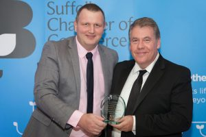 John McNamara Community Relationship manager for Sizewell C Presenting Adam Noble of Pleasurewood Hills with the Commitment to Staff Development Award. Photo -Ferini Media
