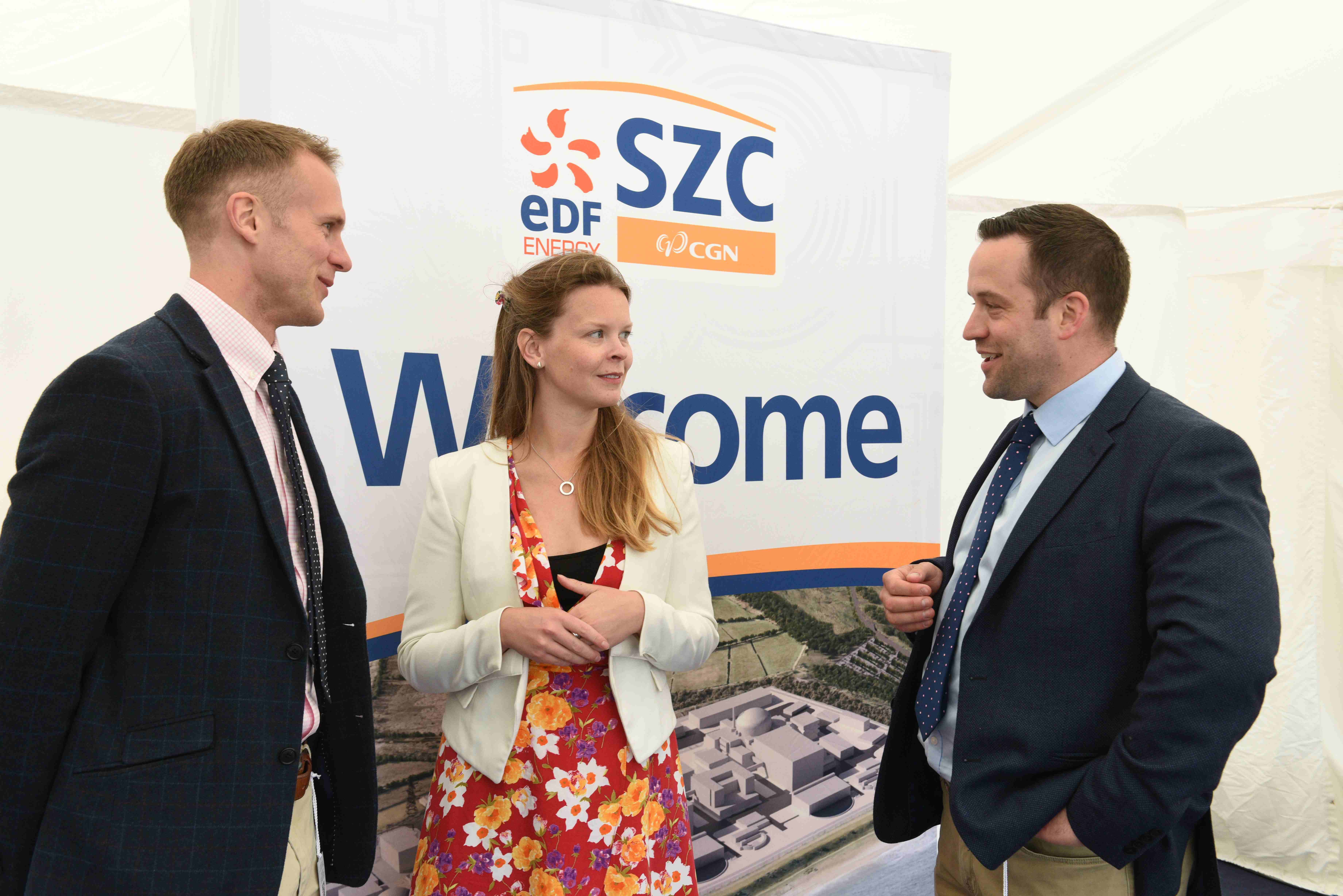 Josh Clarke-Davis (L) and James Gowing (R) from Dalcour Maclaren with Beth Winstone of the Sizewell C project at this year's Suffolk Show